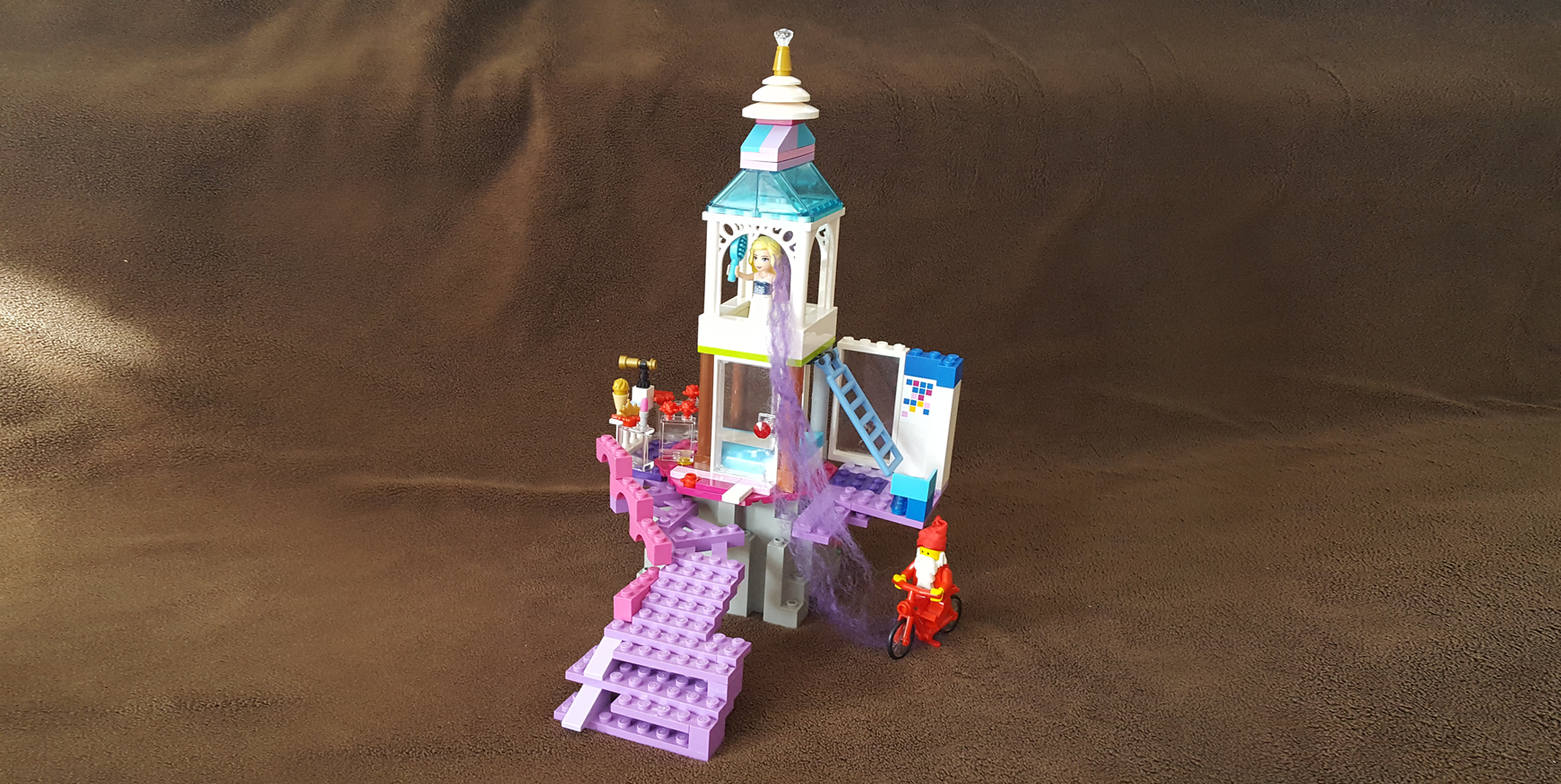 Lego Rapunzel Tower, with a little purple hair.